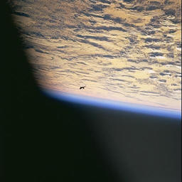 Black UFO Over Earth